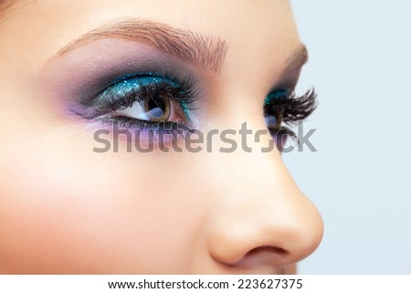 Close-up shot of young beautiful woman's eye zone make-up
