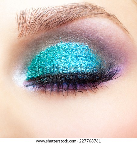 Close-up shot of young beautiful woman's eye zone make-up - stock photo
