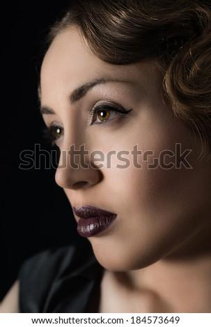 Close-up shot of young dark blond woman face with evening makeup  - stock photo