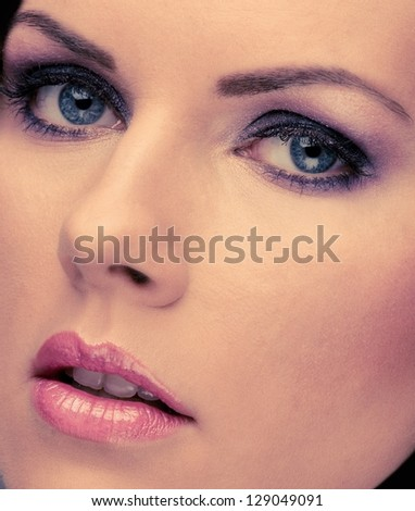Close-up shot of young woman face with make-up