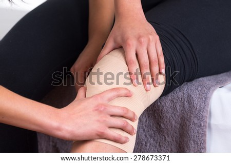Close up shot of young woman lying while getting an leg massage after injury from specialist concept of physiotherapy