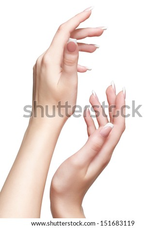 close up shot  of young woman's hands with manicure on white - stock photo