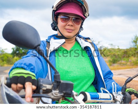 close up shot on woman in adventure outdoor travel by motorbike