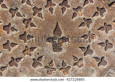Close up shot to a rusty sewer cover - stock photo