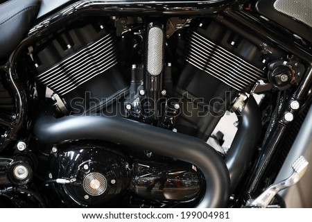 Close-up shot with the engine of a motorcycle. - stock photo