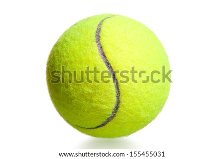 close-up shot yellow tennis ball on a white background - stock photo