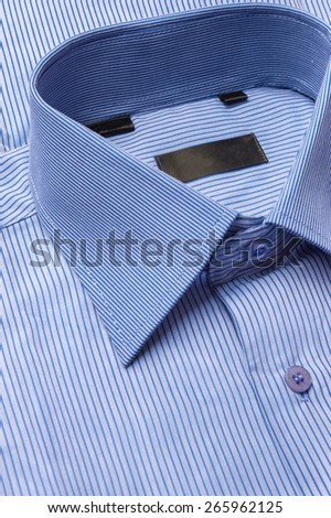 Close up shots of blue striped man's shirt  - stock photo