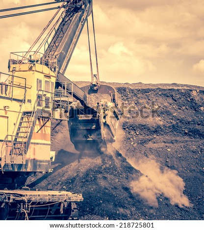close up shovel excavator digging soil in search of lignite in the open-pit mine - stock photo
