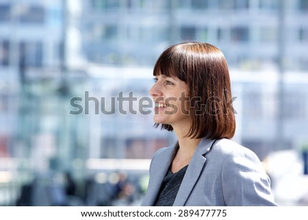Close up side portrait of a confident smiling business woman  - stock photo