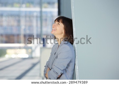 Close up side portrait of an attractive professional business woman smiling - stock photo