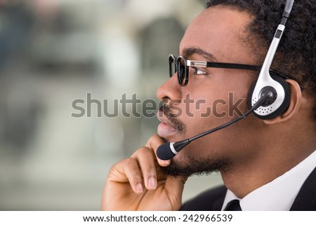 Close-up, side view of confident businessman with a headset. - stock photo