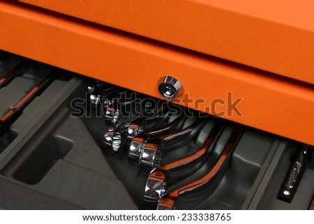 Close up, silver chrome-plated wrench spanner in Tool Cabinets on white background - stock photo