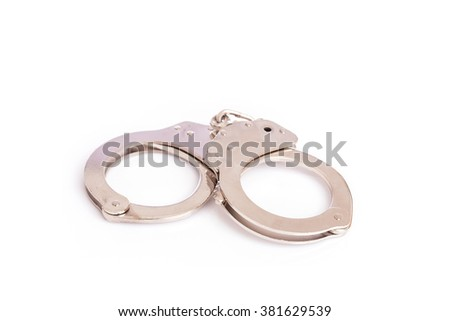 Close up silver handcuffs isolated on white background - stock photo