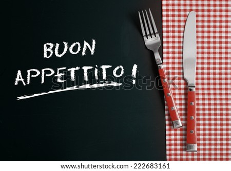 Close up Silverware on Red White Checkered Table Cloth at Buon Appettito - stock photo