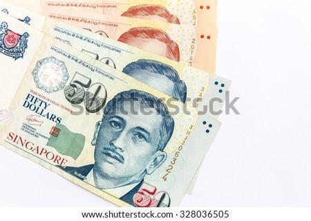close up  singapore money on white background - stock photo