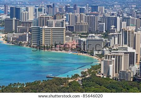 Close-up skyline of Honolulu, Hawaii showing the hotels and buildings on Waikiki Beach - stock photo