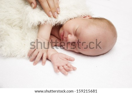 close-up  sleeping baby on a white background - stock photo
