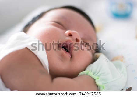 Close-up Sleeping Newborn Asian Baby