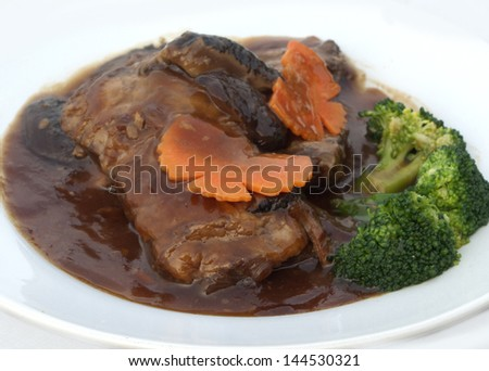 close up slices of roast pork trotters that typically accompanies plain rice - stock photo