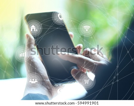Close up smart phones with graphics icon on green background