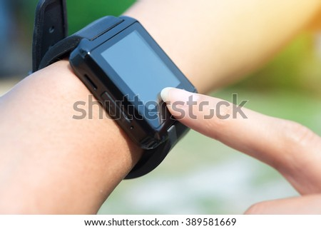 Close-up smart watch it have more application on arm a woman