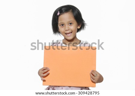 Close up-Smiling little girl holding empty board - stock photo