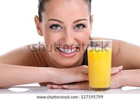 Close up, smiling woman with orange juice - stock photo