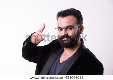 Close up Smiling Young indian bearded man Wearing Eyeglasses, Looking at the Camera Against white Wall Background with Copy Space