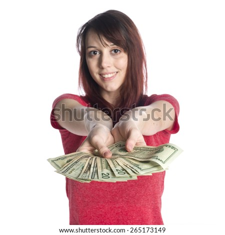 Close up Smiling Young Woman Offering a Fan of 20 US Dollar Bills While Looking at the Camera. Isolated on White Background. - stock photo