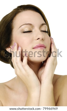 close up smiling young woman resting her chin on hand - stock photo