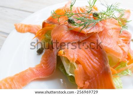Close up smoke salmon on white dish - stock photo