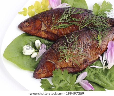 Close up smoked fish on a plate - stock photo