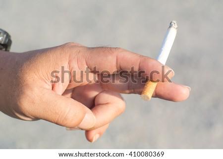 close up smoking cigarette - stock photo