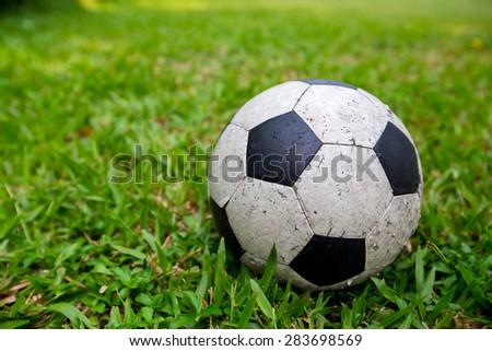 Close-up soccer ball on green grass - stock photo