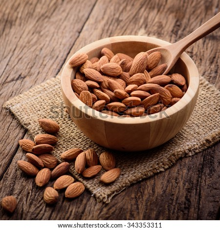 close up some almonds in bowl - stock photo