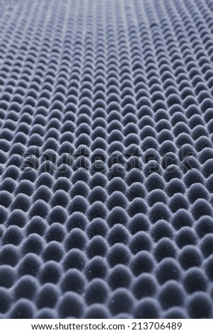 close up sound absorbing sponge in music studio - stock photo