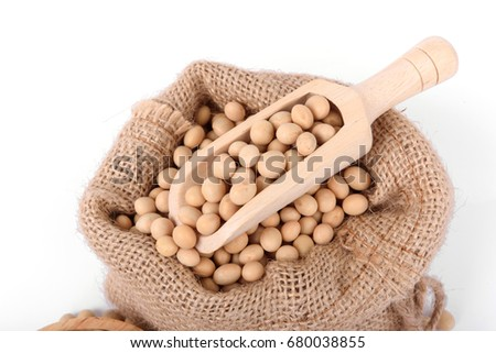 Close up Soy beans on wooden scoop in sack on isolated on white.