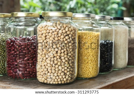 Close up Soybean in a glass jar with multi colour bean - stock photo