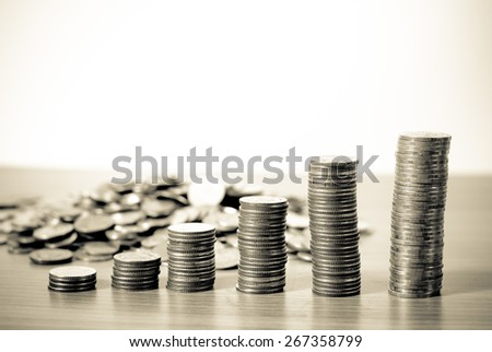 Close-up Stack Of Coins in Growing or success of business and financial concept B&W - stock photo