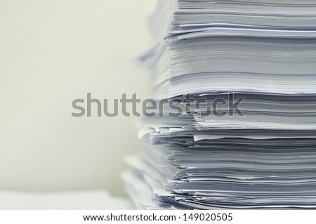 close up stack of paper on white background - stock photo