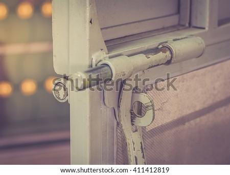Close up steel door unlock, warm retro tone