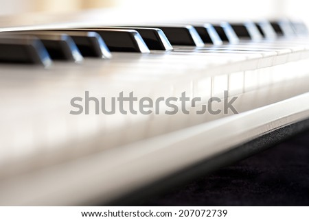 Close-up still life detail profile view of a piano keyboard black and white keys, interior. (Object, Music, Entertainment).