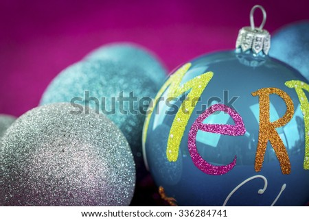 Close Up Still Life of Colorful Festive Glass Christmas Balls with Selective Focus on Striped Ball in Foreground - stock photo