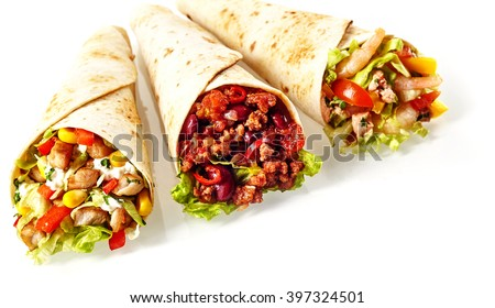 Close Up Still Life of Trio of Tex Mex Fajita Wraps Wrapped in Grilled Flour Tortillas and Filled with Variety of Fillings Such as Chicken, Chili and Shrimp and Fresh Vegetables on White Background