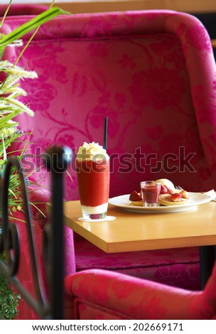 close up strawberry juice and dessert in coffee shop - stock photo
