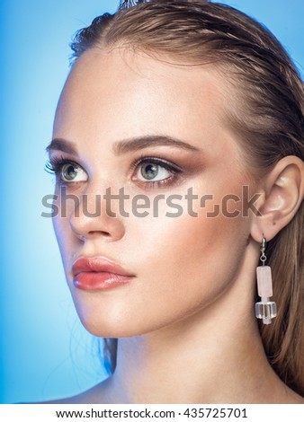 close up studio beauty portrait of young blonde caucasian woman model with wet hair, blue eyes, professional make-up - stock photo