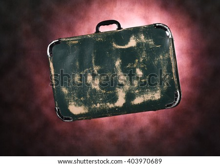 close up studio image of an old fashioned leather suitcase - stock photo
