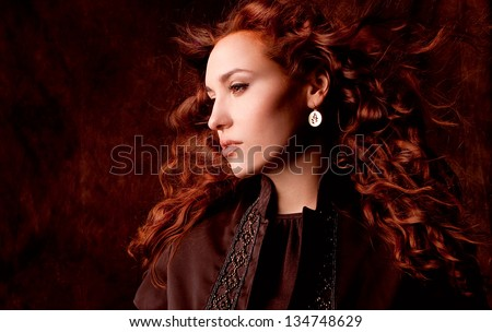 Close up studio portrait of a beautiful girl with perfect red hair - stock photo