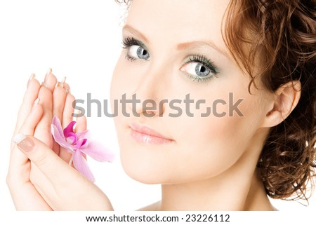 Close-up studio portrait of a beautiful young woman with pink flower, isolated on white background