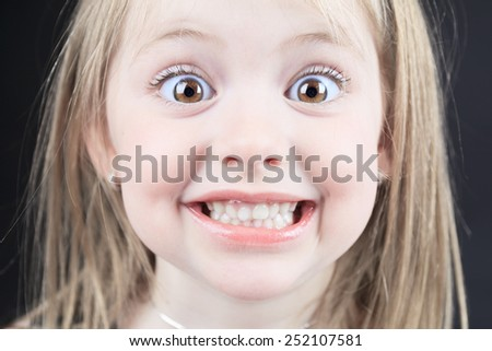 Close Up Studio Portrait Of a Young Girl - stock photo